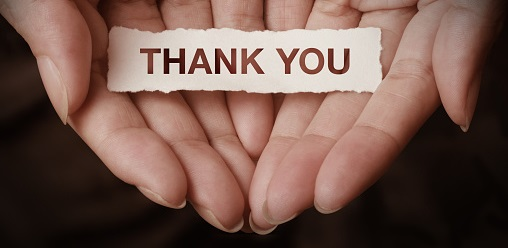 Image of hands with Thank you sign.